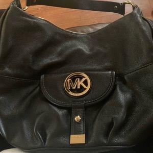 Micheal Kors black leather hobo style handbag